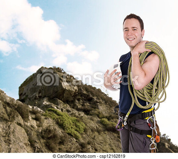 rock climber with equipment including rope, harness and helmet - csp12162819