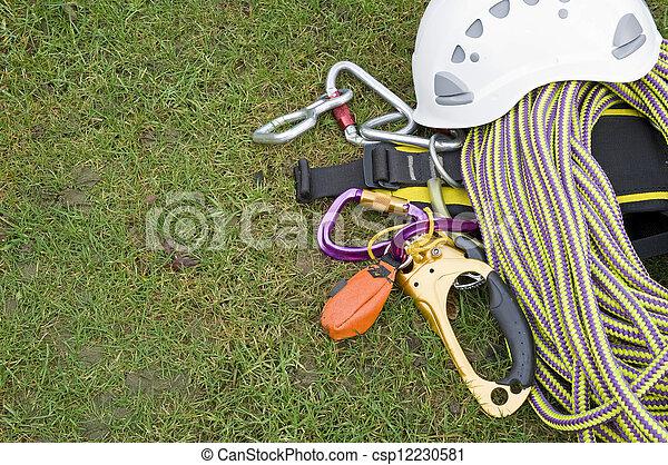 rock climbing equipment on grass - csp12230581