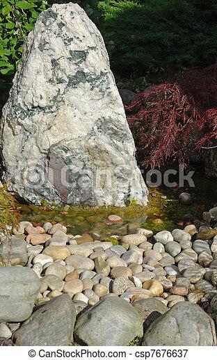 Rockery and pond - csp7676637