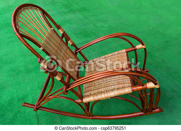 Peachy Rocking Chair Made From Natural Wood And Wicker On A Green Background Side View Spiritservingveterans Wood Chair Design Ideas Spiritservingveteransorg