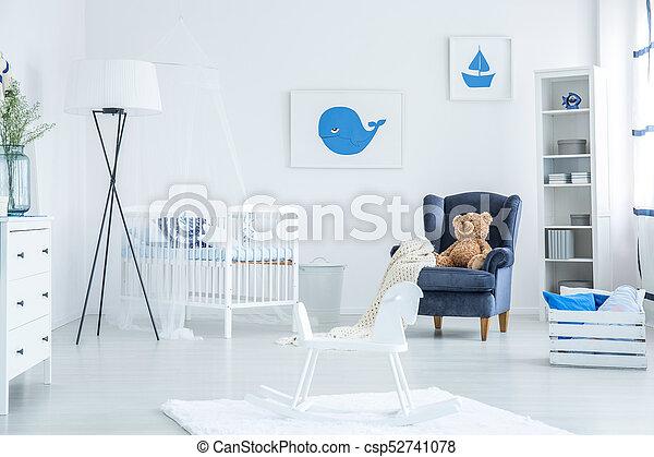 Rocking horse in baby room - csp52741078