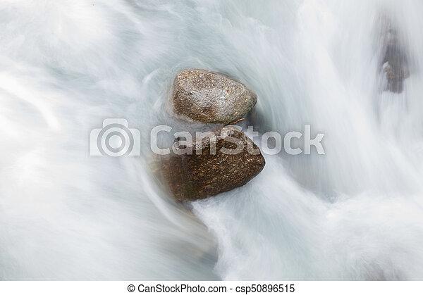 Rocks in a river - csp50896515