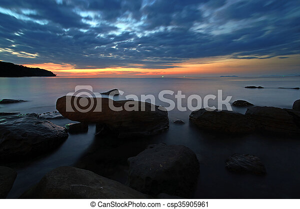 rocks in calm sea - csp35905961