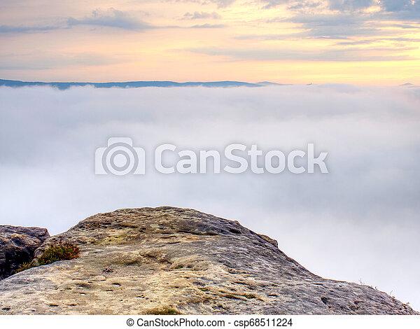 Rocks on the edge of a mountain. Foggy mountain valley - csp68511224