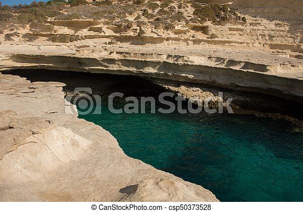Rocky beach in Malta - csp50373528