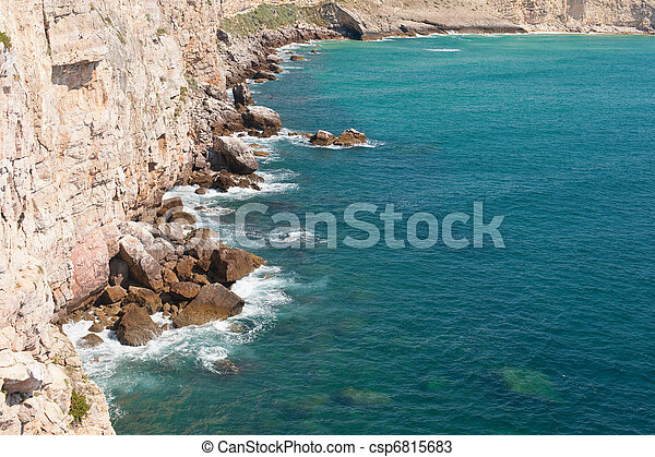 Rocky hills bathing in the ocean - csp6815683