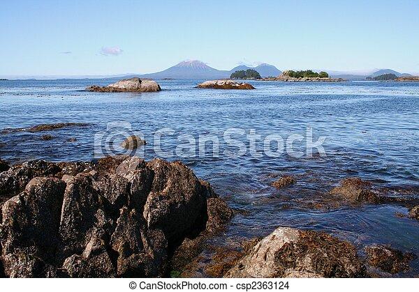 Rocky Shore with Mt. Edgecumbe Volcano - csp2363124