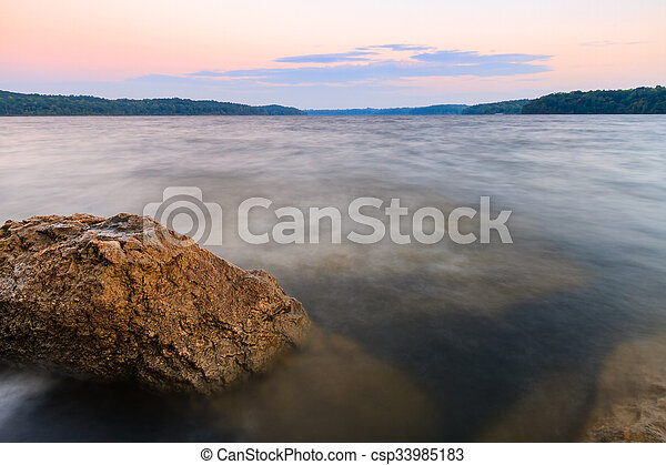 Rocky Shoreline of a lake at sunset - csp33985183