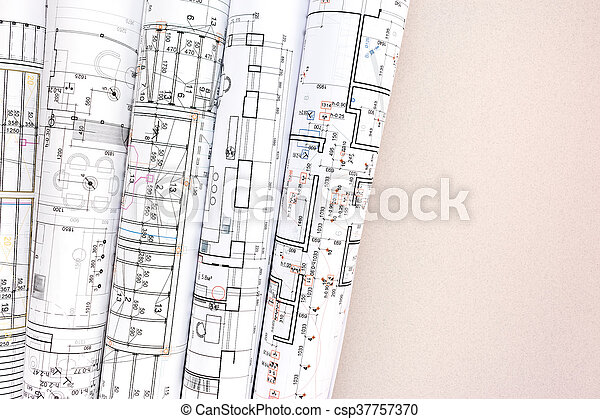 architecture blueprints. Rolled Architectural Blueprints And Technical Drawings On Desk - Csp37757370 Architecture