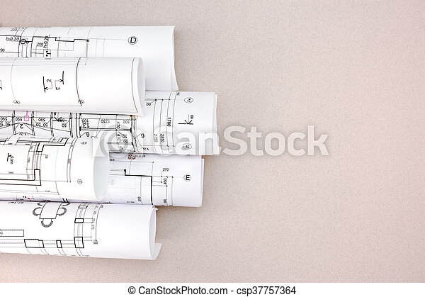 Rolled Architectural Blueprints And Construction Plans On Desk Stock Photo