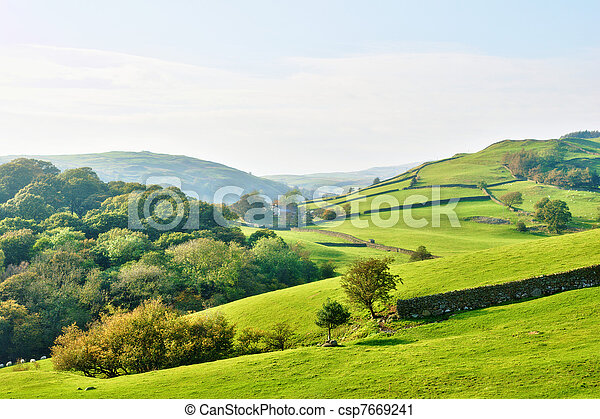 Rolling countryside around a farm - csp7669241