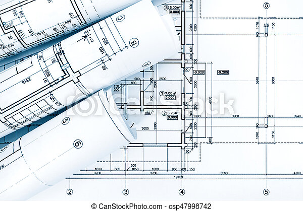 rolls of drawing paper with architectural project plans on blueprint - csp47998742
