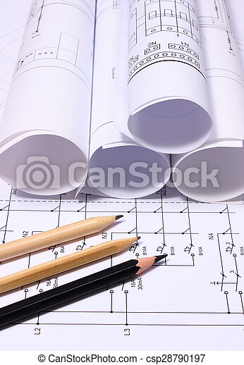 Rolls of electrical diagrams and pencils - csp28790197