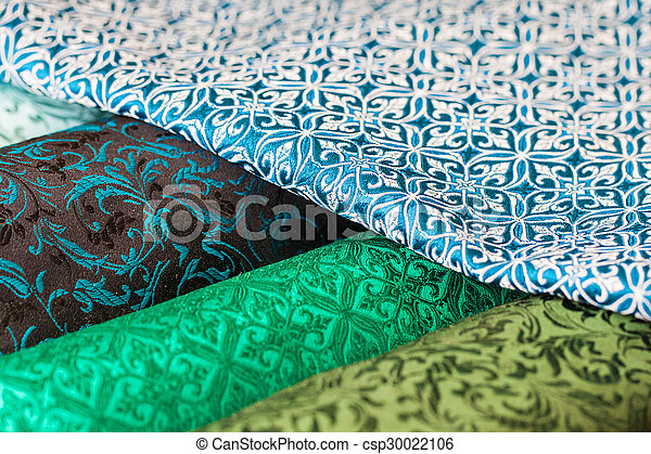 Rolls of fabric and textiles in a factory shop - csp30022106