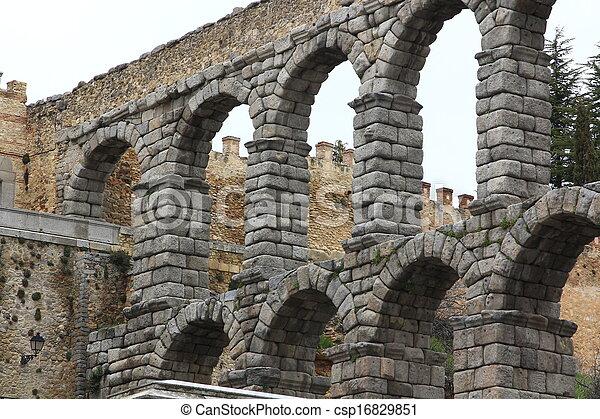 Roman aqueduct in Segovia, Spain - csp16829851