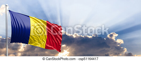 Romania flag on blue sky. 3d illustration - csp51164417