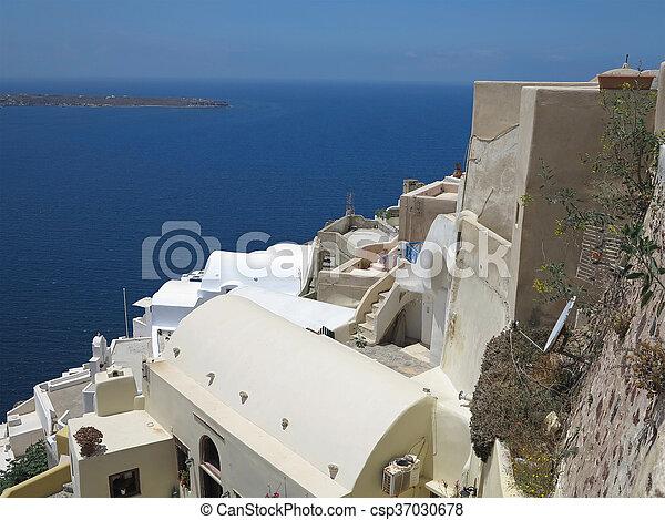 Romantic beautiful cityscape and blue sky of Oia on Santorini in Greece. - csp37030678