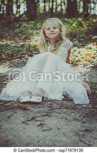 romantic child alone in forest - csp71679130