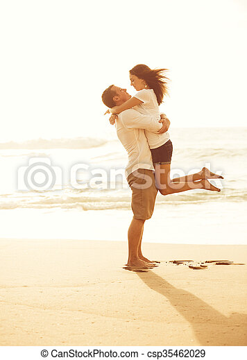 Romantic Couple on the Beach at Sunset. - csp35462029