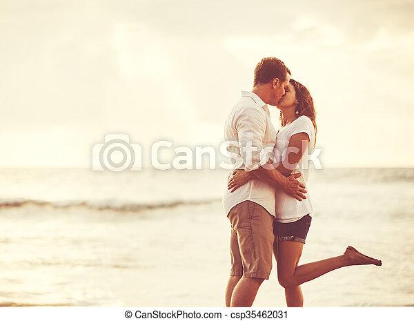 Romantic Couple on the Beach at Sunset. - csp35462031