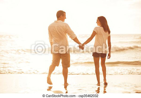 Romantic Couple on the Beach at Sunset. - csp35462032