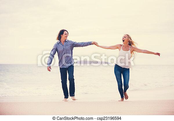 Romantic Couple on the Beach - csp23196594