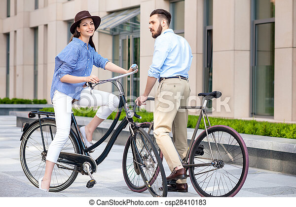 Romantic date of young couple on bicycles - csp28410183