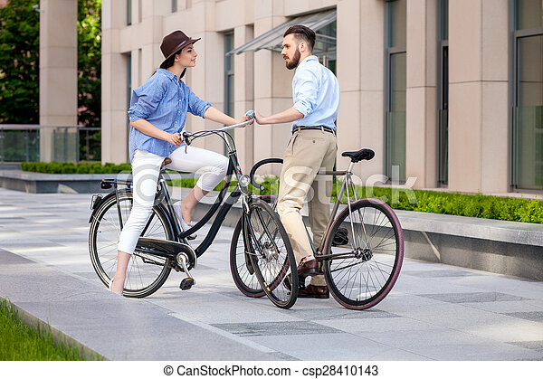 Romantic date of young couple on bicycles - csp28410143