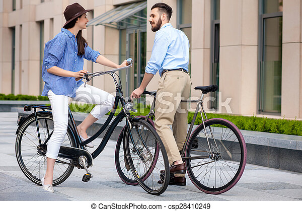 Romantic date of young couple on bicycles - csp28410249