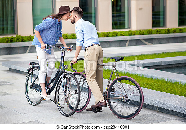 Romantic date of young couple on bicycles - csp28410301
