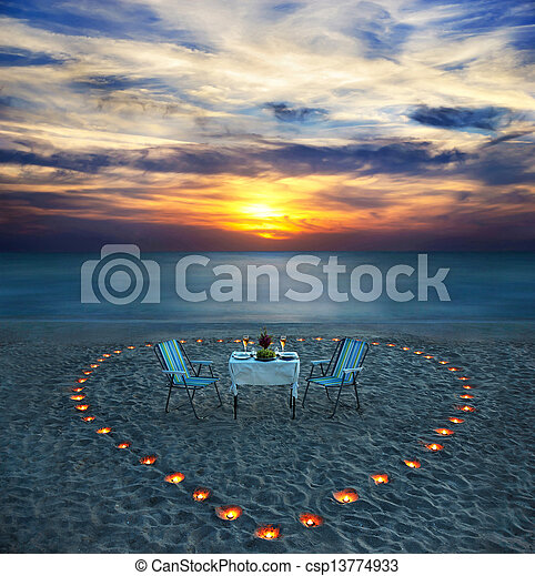 romantic dinner on sea beach with candles - csp13774933