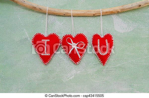 Romantic love composition of red felt hearts - csp43415505
