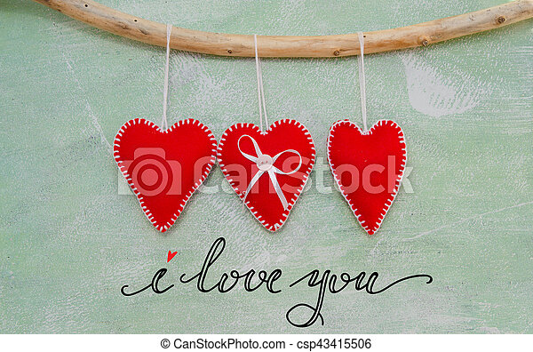 Romantic love composition of red felt hearts - csp43415506