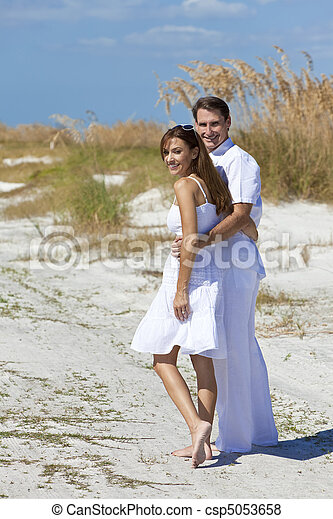 0d6c93e3c93f Romantic man and woman couple walking on an empty beach. Man and ...