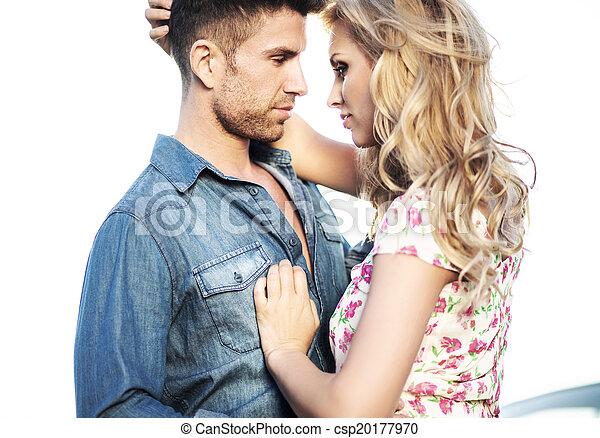 Romantic scene of the kissing couple - csp20177970