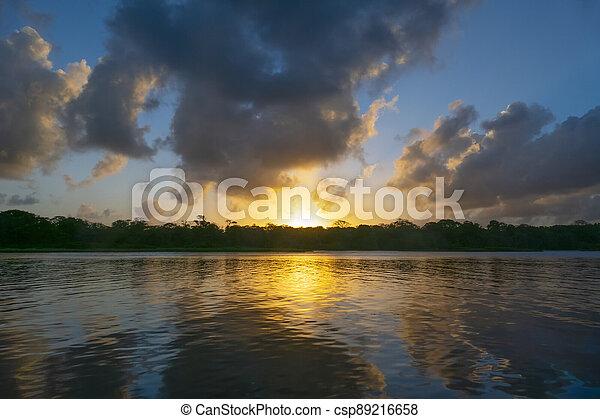 romantic sunset at the beach in Tortugenero in Costa Rica - csp89216658