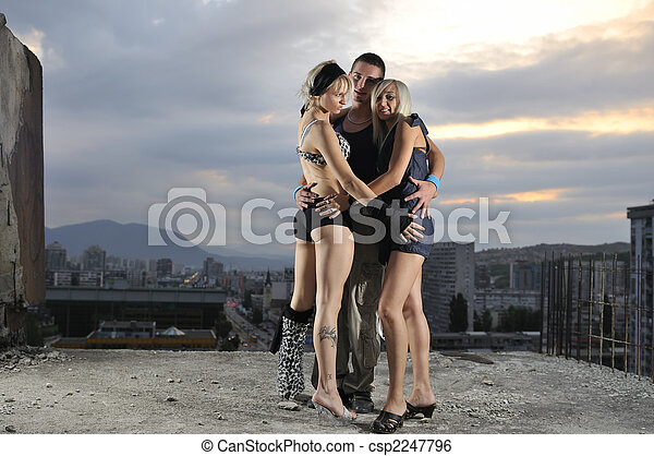 Romantic urban couple dancing on top of the bulding csp2247796