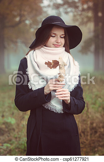 Romantic woman in a hat - csp61277921