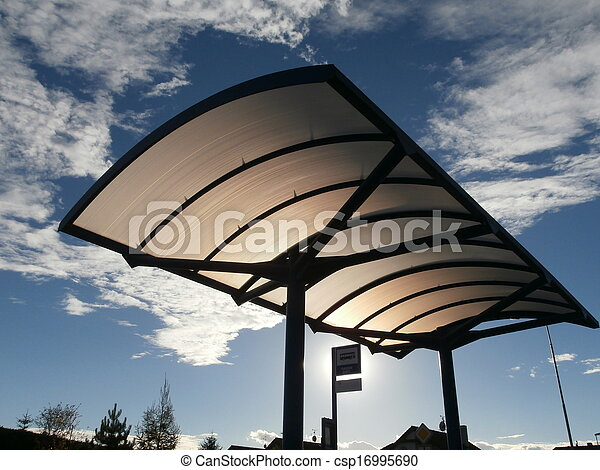 Roof of bus stop lit by evening sun - csp16995690