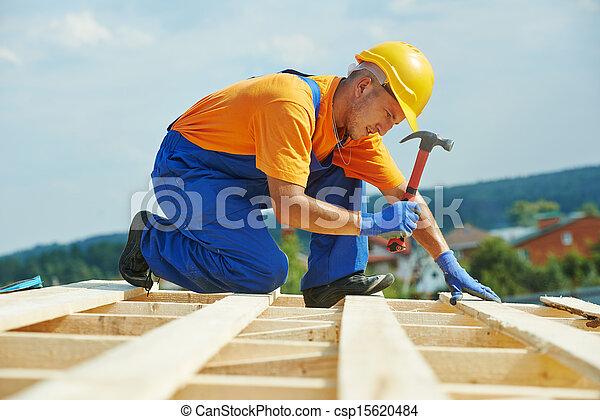 Roofer carpenter works on roof - csp15620484