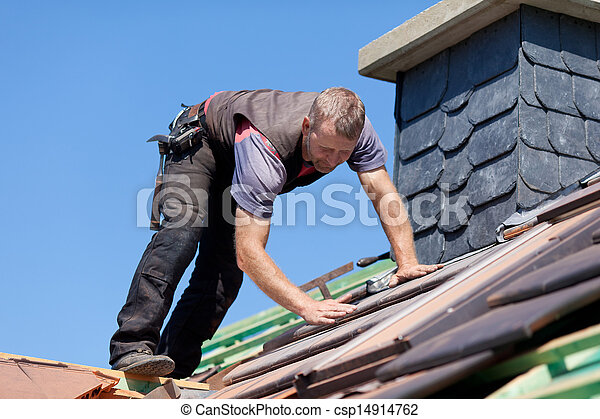 Roofer next to the chimney - csp14914762