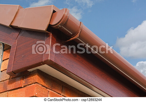 Roofline pvcu soffit fascia board  Close up of brown wood