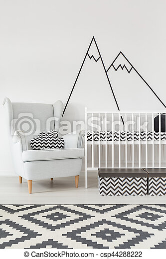 Room with cot and armchair - csp44288222