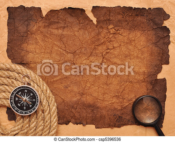 rope coil with compass on old paper - csp5396536