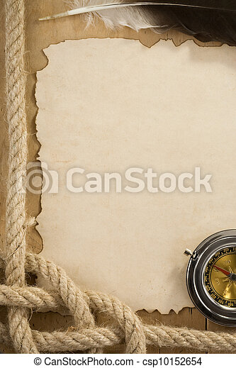ropes and compass on old vintage ancient paper background - csp10152654