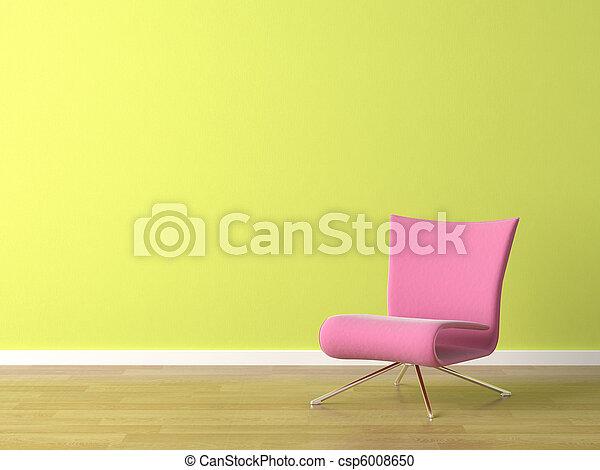 Una silla rosa en la pared verde - csp6008650