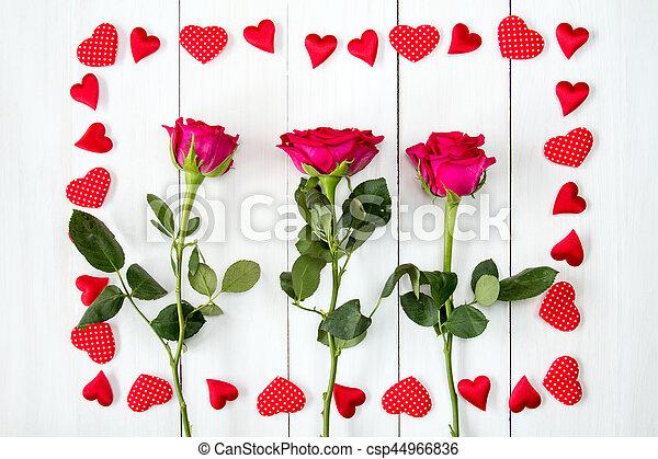 rosas marco tres corazones csp44966836