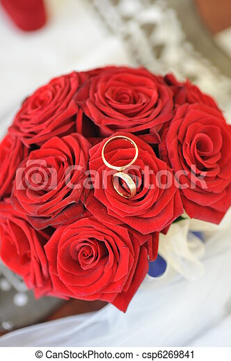 on surrounded by photography rings stock rose wedding desk wooden fresh lying petals two red