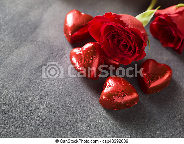 Roses with chocolate hearts on a weddings day background - csp43392009