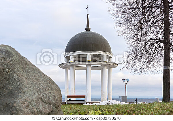 Rotunda on shore of lake in winter - csp32730570